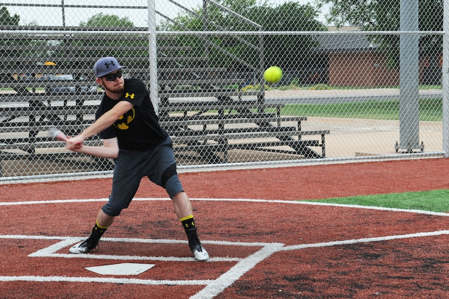 GOODFELLOW AIR FORCE BASE, Texas -- Nicholas O'Keefe, 17th Civil Engineer Squadron Bandits player, swings during a photo shoot at the Mathis Fitness Center multipurpose field June 30. O'Keefe wanted to play softball since he was 2 years old. (U.S. Air Force photo/ Staff Sgt. Laura R. McFarlane)