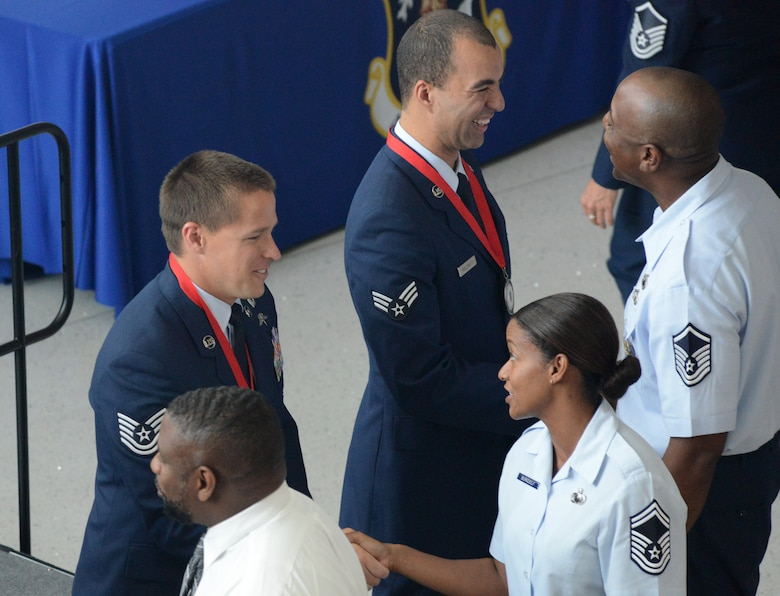 Airmen at the Air National Guard Readiness Center congratulate the ANG's 2014 Outstanding Airmen of the Year during an all call hosted by Lt. Gen. Stanley E. Clarke III, director of the ANG, at the ANGRC on Joint Base Andrews, Maryland, Aug. 7, 2014. The all call was part of Focus on the Force week, a series of events designed to bring the perspective of the enlisted Air Guardsman to ANG leadership, and discuss challenges faced by Airmen across the ANG. (U.S. Air National Guard photo by Senior Airman John E. Hillier/Released)