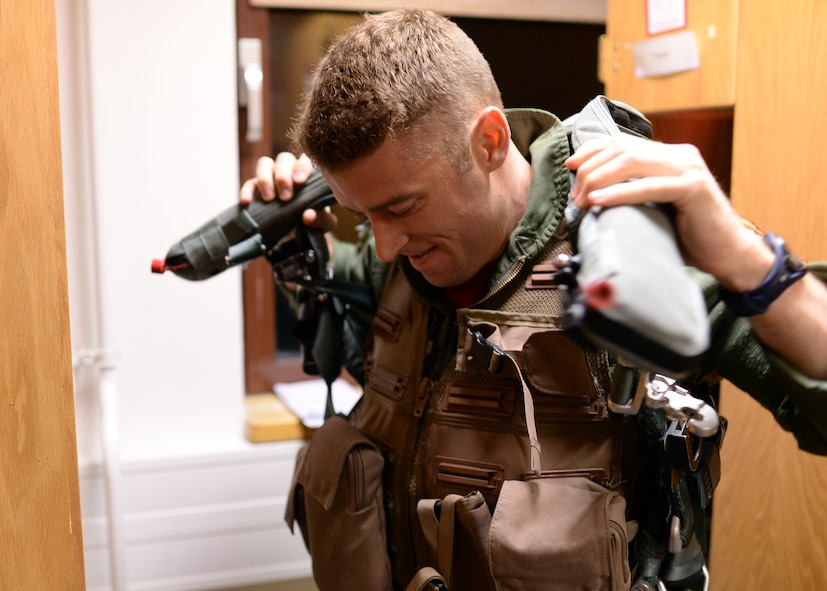 A U.S. Air Force F-16 Fighting Falcon fighter aircraft pilot from the 480th Fighter Squadron at Spangdahlem Air Base, Germany, dons his flight gear Aug. 8, 2014, prior to departing for a bilateral training event to Souda Bay, Greece, Aug. 11-23. Nearly 20 aircraft are participating from Spangdahlem to strengthen the air-to-air compatibility between the U.S. and Greece, with the hopes that such training will lead to regional peace and stability throughout Europe. (U.S. Air Force photo by Staff Sgt. Daryl Knee/Released)