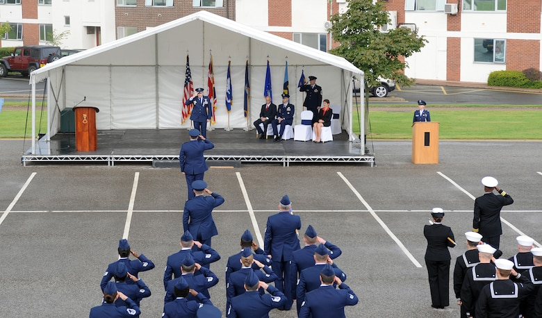 Col. Christopher Gilmore, 691st Intelligence, Surveillance and Reconnaissance Group commander, receives his final salute from service members during a relinquishment of command ceremony Aug. 6, 2014 at Royal Air Force Menwith Hill, England. Gilmore relinquished command of the 691st ISR Group to Col. Kevin Dixon, 70th Intelligence, Surveillance and Reconnaissance Wing commander, during the ceremony.  The 691st ISRG is slated to inactivate later this year. (U.S. Air Force photo/ Staff Sgt. Jeffrey Schultze)