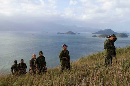 """Brazilian Marines track a simulated enemy up a mountain during a bi-lateral combat tracking exchange held on Marambaia Island, Brazil, Aug. 5, 2014. During the exchange, Brazilian and U.S. Marines with Special Purpose Marine Air Ground Task Force South shared their tactics on tracking enemy personnel and how to spot hidden improvised explosive devices. Through close cooperation, the U.S. and its partners are ready to address transnational security challenges through integrated and coordinated approaches. SPMAGTF-South is currently embarked aboard the future amphibious assault ship USS America (LHA 6) in support of her maiden transit, """"America visits the Americas."""" (U.S. Marine Corps Photo by Cpl. Donald Holbert/ Released)"""