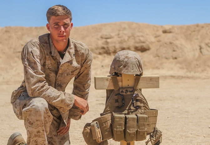 Corporal Tanner Lechner, a combat engineer with Combat Service Support Company, 1st Brigade Headquarters Group, 1st Marine Expeditionary Brigade, supports the MEB through woodwork during Large Scale Exercise 2014 aboard Marine Corps Air Ground Combat Center Twentynine Palms, Calif., Aug. 4, 2014. LSE-14 is a bilateral training exercise being conducted by 1st MEB to build U.S. and Canadian forces' joint capabilities through live, simulated, and constructive military training activities from Aug. 8-14. (U.S. Marine Corps photo by Lance Cpl. Angel Serna/Released)