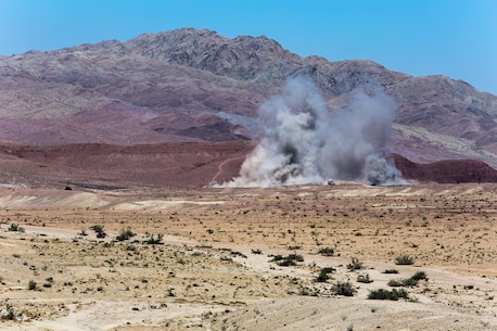 A series of impacts from artillery and air fire make up an explosion seen in the the distance as a result of combined arms trainining conducted by Marines of 1st Battalion, 1st Marine Regiment, 1st Marine Expeditionary Brigade in support of Large Scale Exercise 2014 aboard Marine Corps Air Ground Combat Center Twentynine Palms, Calif., Aug. 9. LSE-14 is a bilateral training exercise being conducted by 1st MEB to build U.S. and Canadian forces' joint capabilities through live, simulated, and constructive military training activities from Aug. 8-14, 2014. (U.S. Marine Corps Photo by Cpl. Rick Hurtado/Released)