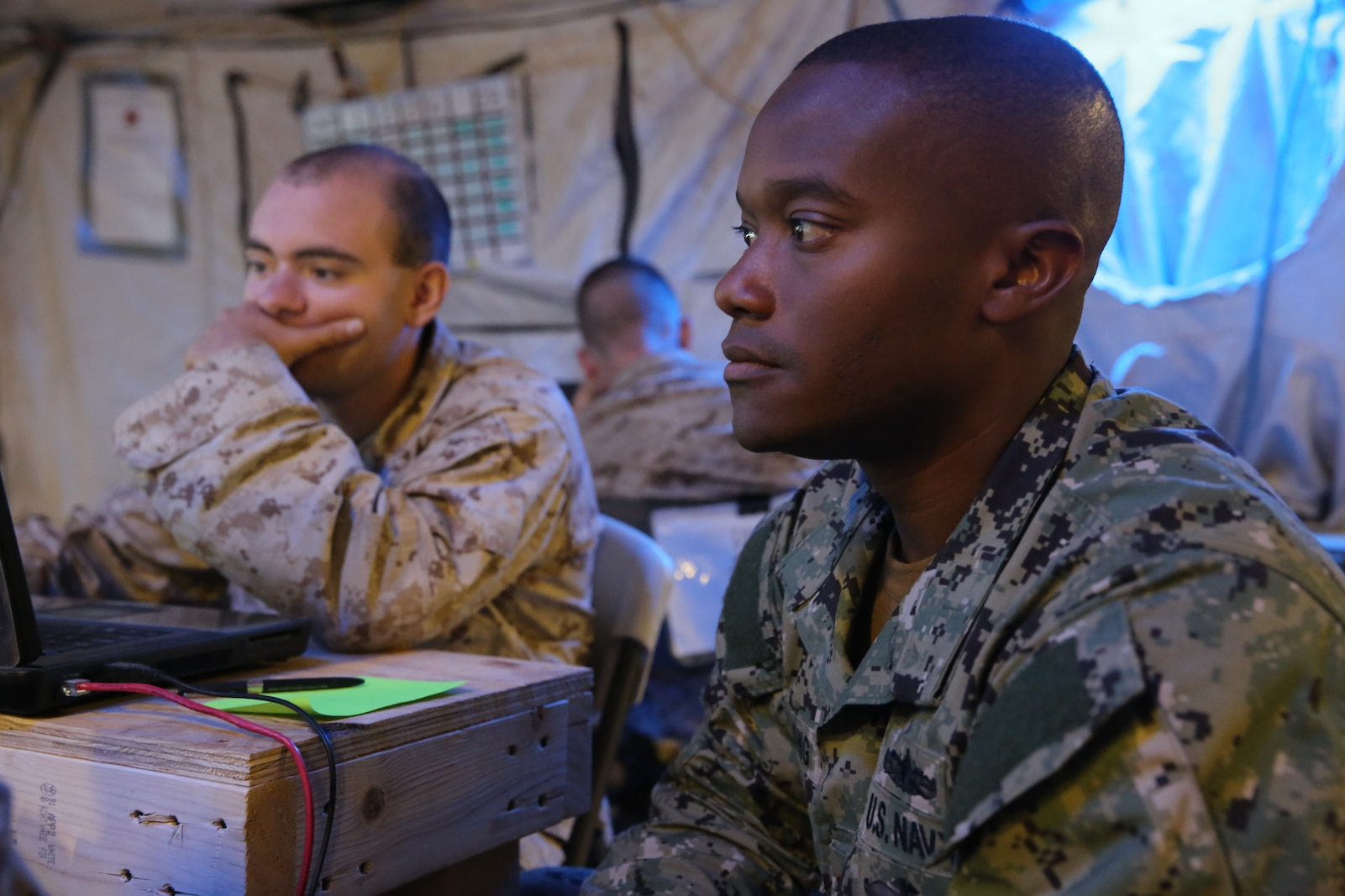 Navy Lt. Cmdr. Jonathan Long, right, representing the fires officer of the Expeditionary Strike Group 3, and Cpl. Charles Stephens, a command control communications computer specialist with 1st Marine Expeditionary Brigade, practice coordinating fire missions during Large Scale Exercise 2014 here, Aug. 10, 2014. LSE-14 is a bilateral training exercise being conducted by 1st MEB to build U.S. and Canadian forces' joint capabilities through live, simulated, and constructive military training activities. The exercise also promotes interoperability and cooperation between joint, coalition, and U.S. Marine Forces, providing the opportunity to exchange knowledge and learn from each other, establish personal and professional relationships and hone individual and small-unit skills through challenging, complex and realistic live scenarios with special focus on building combat power ashore.
