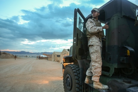 Sergeant Luis Palomar, a motor transportation operator with 1st Brigade Headquarters Group, 1st Marine Expeditionary Brigade, from Escondido, Calif.,  prepares to mount a 7-ton Medium Tactical Vehicle prior to leaving on the first of two convoys from Marine Corps Air Ground Combat Center Twentynine Palms to Marine Corps Base Camp Pendleton, Calif., Aug. 12, 2014. 1st MEB Marines started tearing down Camp Francis and transported the gear as Large Scale Exercise 2014 comes to an end. LSE-14 is a bilateral training exercise being conducted by 1st MEB to build U.S. and Canadian forces' joint capabilities through live, simulated, and constructive military training activities from Aug. 8-14.