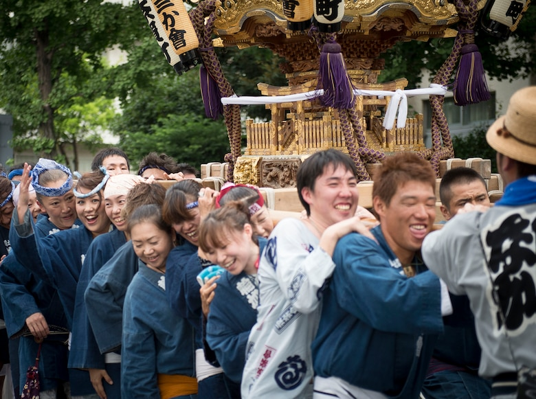 Local residents carry a mikoshi shrine in Fussa City, Japan, Aug. 8, 2013, during the 64th annual Fussa Tanabata Festival. The festival included traditional Japanese dance performances and groups carrying mikoshi shrines from Shinmeisya Shrine to Fussa City Hall. (U.S. Air Force photo by Airman 1st Class Meagan Schutter/Released)