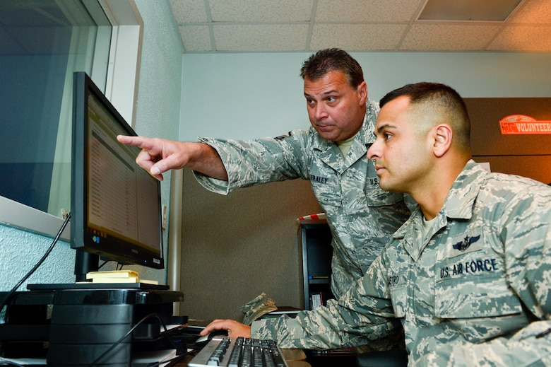 MCGHEE TYSON AIR NATIONAL GUARD BASE, Tenn. -- Master Sgt. Stephen Fraley, left, and Master Sgt. Juan Castro connect the training and education needs of the Air National Guard, government agencies and other services here July 28, 2014, with resources available at the I.G. Brown Training and Education Center. (U.S. Air National Guard photo by Tech. Sgt. Jonathan Young/Released)