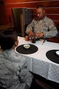 Tech. Sgt. Joseph Holton prepares tea in the USO lounge at the Charles C. Carson Center for Mortuary Affairs, Dover Air Force Base, Del., Aug. 12, 2014, for fellow deployers from the 512th Memorial Affairs Squadron here. Holton introduced the benefits of drinking tea on his last rotation to the mortuary. (U.S. Air Force photo/Master Sgt. Christopher Gish)