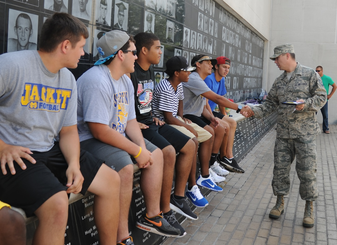 Tech. Sgt. Nick Gagne, 338th Training Squadron, talks to St. Martin High School senior football players about the importance of a positive attitude in all situations during a leadership seminar Aug. 9, 2014, at the Mississippi Vietnam Veterans Memorial in Ocean Springs, Miss. The seminar was a collaboration of the St. Martin Gridiron Club and Keesler personnel, who also briefed the seniors on good attitudes, values, beliefs and teamwork.  (Courtesy photo by Kemberly Groue)