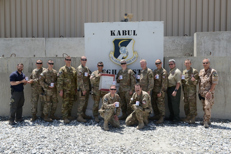 """A group of U.S. joint and coalition deployed servicemembers who are among the """"Gavin Fan Club"""" at Forward Operating Base Oqab in Kabul, Afghanistan. (U.S. Air Force photo/Senior Master Sgt. Mike Hammond)"""