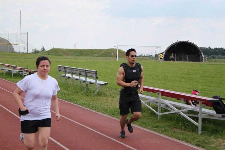U.S. Air Force Staff Sgt. Pamela Lozano, 52nd Logistics Readiness Squadron NCO in charge of personal property from Straudsburg, Pa., left, runs around the track at Spandahlem Air Base, Germany, in 2012 prior to changing her lifestyle and dedicating herself to healthy living. During the following two years, Lozano changed her diet, quit smoking and lost 25 pounds. (Courtesy photo/Released)