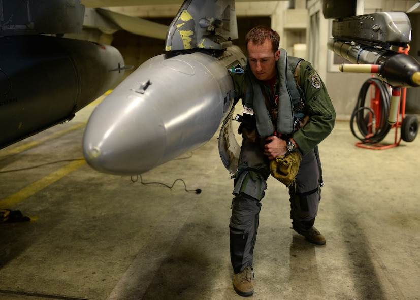 U.S. Air Force Capt. Taylor Blevins, a U.S. Air Force F-16 Fighting Falcon fighter aircraft pilot from the 480th Fighter Squadron at Spangdahlem Air Base, Germany, loads his gear into a pod Aug. 8, 2014, before flying to a training event with the Hellenic air force in Souda Bay, Greece, Aug. 11-23. These types of training events aim to build relationships and capabilities of NATO allies. (U.S. Air Force photo by Staff Sgt. Daryl Knee/Released)