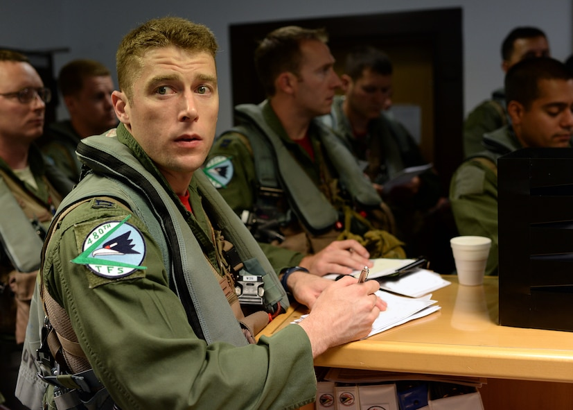 A U.S. Air Force F-16 Fighting Falcon fighter aircraft pilot from the 480th Fighter Squadron at Spangdahlem Air Base, Germany, reviews his flight information before departing for Souda Bay, Greece, for a training event between the U.S. and Hellenic air forces Aug. 11-23. The goal of the training event is to strengthen the ties between the two nations and increase their NATO military capability. (U.S. Air Force photo by Staff Sgt. Daryl Knee/Released)