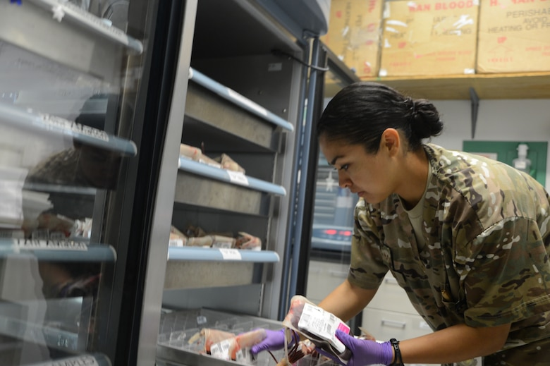 U.S. Air Force Senior Airman Kandie Ibarra, a lab technician assigned to the 455th Medical Support Squadron, gathers blood bags in preparation of an emergency call that she must respond to while working at the Craig Joint Theater Hospital, Bagram Airfield, Afghanistan, June 23, 2014. CJTH remains as one of the busiest hospitals in Afghanistan supporting Operation Enduring Freedom. (U.S. Air Force photo by Master Sgt. Cohen A. Young/Released)
