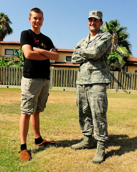 Capt. Michael Floyd, 39th Force Support Squadron manpower and personnel flight commander, stands with Danny Vaughn, III August 11, 2014, Incirlik Air Base, Turkey. Floyd helped Vaughn after a bike crash in their neighborhood. (U.S. Air Force photo by Staff Sgt. Eboni Reams/Released)