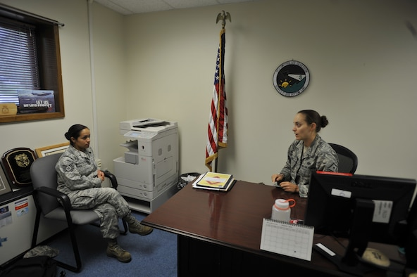 Master Sgt. Jessica McWain, 51st Fighter Wing Staff Agencies and Comptroller Squadron first sergeant, explains the different duties and responsibilities of being a first sergeant to Tech. Sgt. Alejandra Chavez, 51st FW Equal Opportunity NCO-in-charge, on Osan Air Base, Republic of Korea, Aug. 7, 2014. Chavez hopes to become a first sergeant and make a difference in the lives of her future Airmen. (U.S. Air Force photo/Senior Airman David Owsianka)