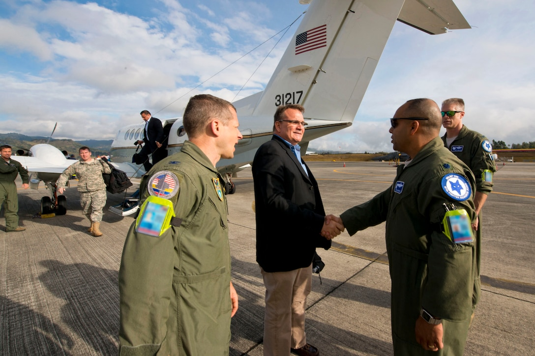 Lt. Col.Akshai Ghandi, right, greets Mr. Benjamin Ziff during the first day of Relampago 2014,  Aug. 11, 2014, in Rionegro, Colombia. Relampago is a combined air cooperation engagement with Colombia. Airmen and F-16 Fighting Falcons from the 169th Fighter Wing will participate in the first major joint-air training opportunity under the auspices of the South Carolina National Guard's State Partnership Program with the country of Colombia. Ghandi is the 157th Fighter Squadron commander assigned to  South Carolina Air National Guard's 169th Fighter Wing at McEntire Joint National Guard Base, and Ziff is the  deputy chief of mission for the U.S. Embassy in Colombia  (U.S. Air National Guard photo/Tech. Sgt. Jorge Intriago)