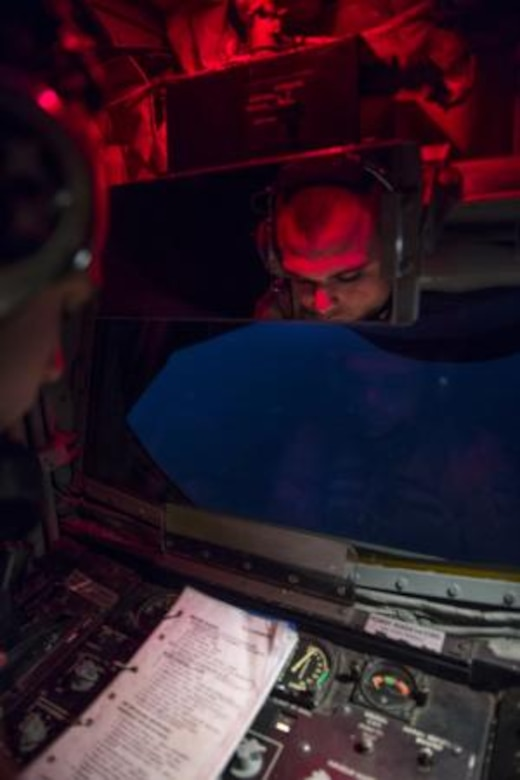 Airman 1st Class Kevin Haggith, 340th Expeditionary Air Refueling Squadron, KC-135 Stratotanker boom operator, reads through a boom operator checklist prior to providing fuel to an F-16 Fighting Falcon over Iraq, Aug. 12, 2014. As the boom operator for the mission, Haggith is responsible for assisting the aircraft commander, off-loading fuel to receivers, briefing passengers and recording the mission through computer devices. The aircrew off-loaded 40,000 gallons of fuel to Fighter Aircraft completing missions in Iraq. (U.S. Air Force photo by Staff Sgt. Vernon Young Jr.)