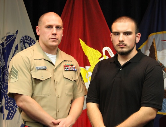 Aaron Hunter, right, a 19-year-old native of Lynchburg, Va., stands next to U.S. Marine Corps Sgt. Christopher Bangert, a canvasing recruiter at Recruiting Sub-Station Lynchburg, after Hunter officially swore into the Marine Corps' Delayed Entry Program, Aug. 8, 2014. The new Marine Corps poolee worked for almost two years to lose 84 pounds to be eligible to enlist in the Corps. Through old fashioned hard work, determination, and some motivation from the local Marine recruiters, Hunter met his goal and is now awaiting his turn to at recruit training to earn the coveted title of Marine. (U.S. Marine Corps photo by Cpl. Aaron Diamant/Released)