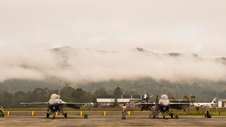 U.S. Air Force F-16 Block 52 fighters, assigned to the 169th Fighter Wing from McEntire Joint National Guard Base of the South Carolina Air National Guard, sit on the ramp at Rionegro, Colombia, Aug. 12, 2014 during Relampago (Lightning) 2014. Relampago is a combined air cooperation engagement with the Republic of Colombia. One hundred Airmen and six F-16s are participating in the first major joint-air training opportunity under the auspices of the South Carolina National Guard's State Partnership Program with the country of Colombia. (U.S. Air National Guard photo by Tech. Sgt. Jorge Intriago/Released)