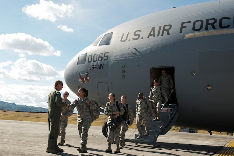 U.S. Airmen, assigned to the 169th Fighter Wing from McEntire Joint National Guard Base of the South Carolina Air National Guard, disembark from a C-17 Globemaster III, from the Tennessee Air National Guard, Aug. 9, 2014, at Rionegro, Colombia during Relampago (Lightning) 2014. Relampago is a combined air cooperation engagement with the Republic of Colombia. One hundred Airmen and six F-16s are participating in the first major joint-air training opportunity under the auspices of the South Carolina National Guard's State Partnership Program with the country of Colombia. (U.S. Air National Guard photo by Tech. Sgt. Jorge Intriago/Released)