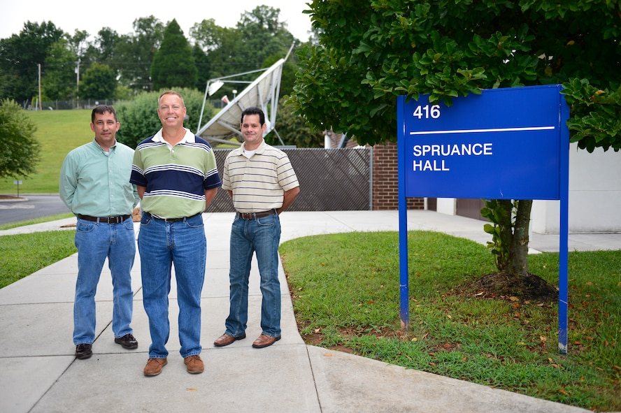 MCGHEE TYSON AIR NATIONAL GUARD BASE, Tenn. -- The Federal Government Distance Learning Association recognized the I.G. Brown Training and Education Center here recently with the 2014 Innovation Award. From left, David Barlow, graphics manager, Gerry Barnes, Warrior Network director and broadcast engineer, Ron Waite, broadcast engineer. (U.S. Air National Guard photo by Master Sgt. Mike R. Smith/Released)