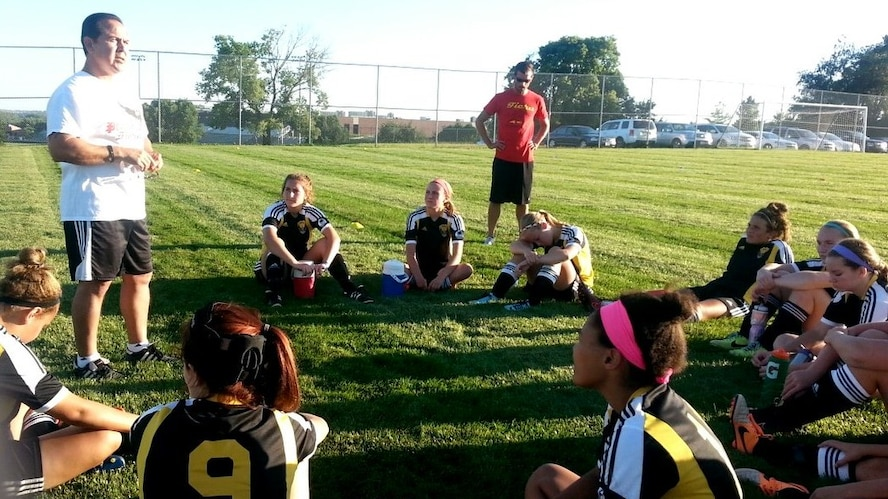 Retired U.S. Air Force Master Sgt. Richard Esparza, 55th Medical Group medical readiness manager, delivers a half-time speech to his under-15 girls premier team, Fiera, during a recent game. Esparza has been coaching soccer for nearly two decades. (U.S. Air Force courtesy photo)