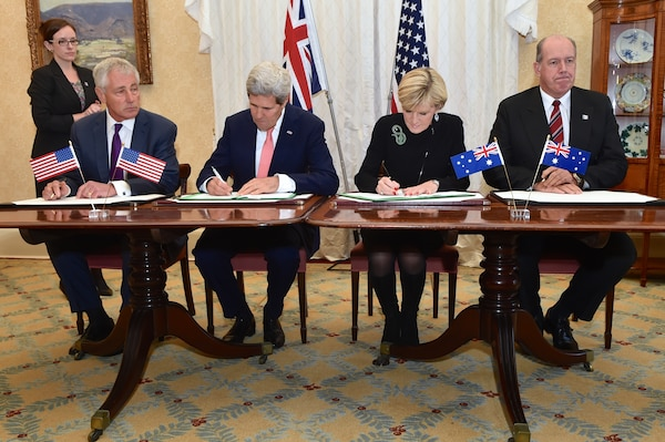 U.S. Secretary of State John F. Kerry, center left, and Australian Foreign Minister Julie Bishop, center right, flanked by U.S. Defense Secretary Chuck Hagel, left, and Australian Defense Minister David Johnston, right, sign a force posture agreement during bilateral defense and diplomatic meetings in Sydney, Aug. 12, 2014. State Department photo