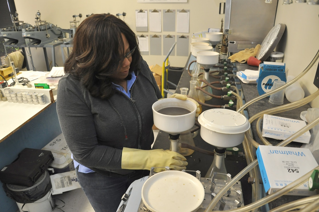 MARIETTA, Ga. – Angie Bacon, civil engineering technician, tests soil samples for classification using beakers and funnels at the U.S. Army Corps of Engineers Savannah District Environmental and Materials Unit.