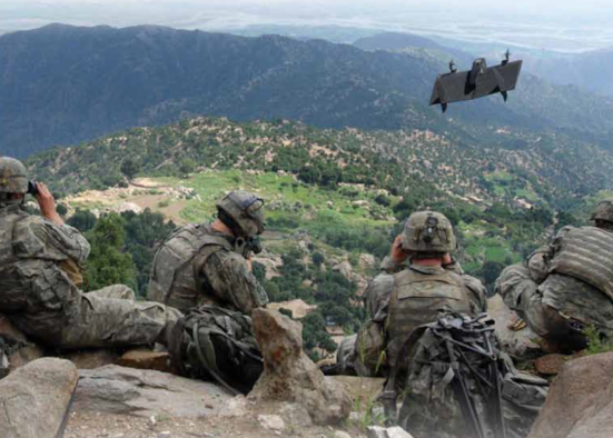 Service members operate a Skate device, a small unmanned aircraft system, in field testing. (Courtesy photo)