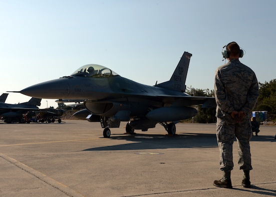 Senior Airman Alan Nelson watches an F-16 Fighting Falcon prepare for takeoff Aug. 12, 2014, during a bilateral training event in Souda Bay, Greece. The U.S. and Hellenic air forces prepare more than 20 aircraft launches a day for during the two-week bilateral training event. Nelson is with the 480th Aircraft Maintenance Unit, Spangdahlem Air Base, Germany, and is a native of Pensacola, Fla. (U.S. Air Force photo/Staff Sgt. Daryl Knee)