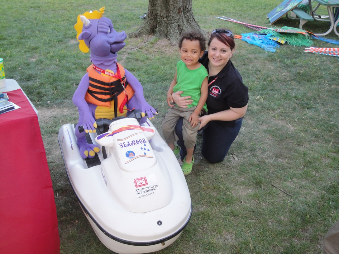 """""""Wear your lifejacket!"""" That was the message U.S. Army Corps of Engineers, Buffalo District team members were promoting at the Lake Erie Waterfest event, Miller Road Park, Avon Lake, OH.    Seamoor was out on the """"prowl"""" to look for people to share water safety information with and of course, to squirt them with water! The children immediately flocked to the """"purple dragon-looking thing driving a jet ski"""". Even the adults had fun when they got sprayed by Seamoor."""