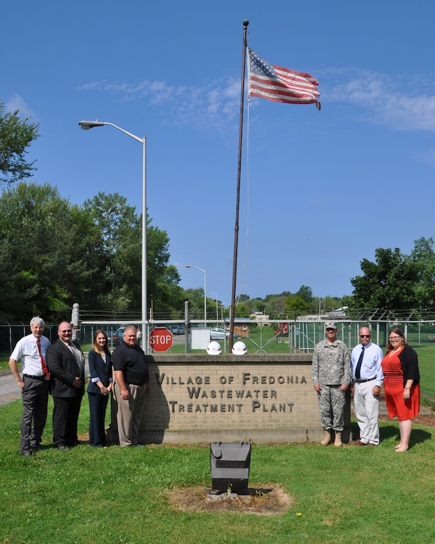 Ground was broken on the Canadaway Creek Sewer Line Protection Project, Dunkirk, NY, August 12, 2014. (Left to Right: State Assemblyman Andrew Goodell, Project Manager Casey Brzozowiec, Congressmen Reed's representative Carle Whisner, State Senator Catherine Young's representative Kevin Muldowney U.S. Army Corps of Engineers, Buffalo District Commander LTC Karl Jansen, Village of Fredonia Mayor Steve Keefe, Congressmen Reed's representative Jacquelyn Chiarot)   The contract, awarded to Strock Enterprises LTD, is for construction of a trench-fill revetment, along approximately 800 feet of the creek's left bank, parallel to the main sewer line. The revetment is constructed by first digging a ditch along the creek, filling it with a combination of steel mesh and rip rap, and then back filling and covering the ditch. As the shore erodes with time, the rip rap with fall into place and create a natural protected creek bank.