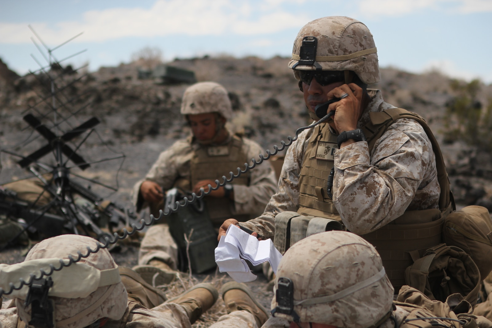 Captain Javier Gonzalez, an infantry officer with Company F, 2nd Battalion, 7th Marine Regiment, conducts a radio operations check for a fire support operation during Large Scale Exercise 2014 aboard Marine Corps Air Ground Combat Center Twentynine Palms, Calif., Aug. 9-10, 2014. Fire support drills are conducted by a fire team that calls for attacks on distant targets through the use of air support, mortars and artillery. LSE-14 is a bilateral training exercise being conducted by 1st Marine Expeditionary Brigade to build U.S. and Canadian forces' joint capabilities through live, simulated, and constructive military training activities. (U.S. Marine Corps photo by Lance Cpl. Angel Serna/Released)