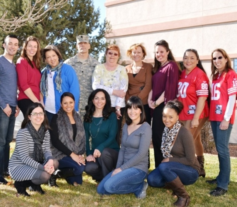 ALBUQUERQUE, N.M., -- The Contracting team of the Albuquerque District received the Excellence in Contracting Award PARC-Dallas for their outstanding performance in fiscal year 2013. Back row (l-r): Joseph Rael; Erica Talley; Monique Chisholm; Lt. Col. Joseph Davis; Linda Anderson, Kathleen Mayer; Madeline Livermore; Beverly Dodson; Karen Irving. Front row (l-r): Stephanie Parra; Francesca Luna; Leslie Molina; Diana Keeran; Kiera Robinson. Not pictured are Stuart Christianson and Glenda Kohlieber.