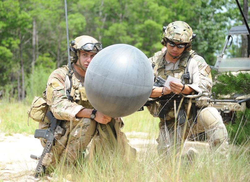 Members of the 10th Combat Weather Squadron prepare to release a weather balloon during a training exercise July 31, 2013 at the Eglin Range, Fla. SOWTs provide immediate and accurate weather information and forecasts deep behind enemy lines. (U.S. Air Force photo by Capt. Victoria Porto)