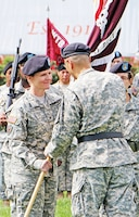 Col. Risa Ware, left, receives unit colors from Brig. Gen. John M. Cho, commanding general, Western Regional MEDCOM, and becomes commander for IACH during a change of command ceremony July 16 at Cavalry Parade Field.