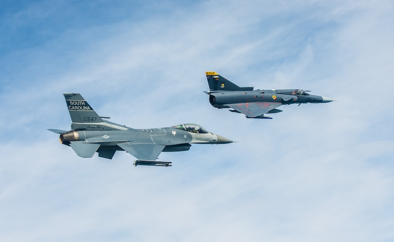 A South Carolina Air National Guard F-16 flies alongside a Colombian air force Kfir during a training flight Aug. 12 over Colombia. Nearly 100 Airmen and six F-16s from the 169th Fighter Wing at McEntire Air National Guard Base are participating in the combined air operation engagement, which is the first major joint-air engagement opportunity under the auspices of the South Carolina's State Partnership Program with Colombia. (U.S. Air Force photo by Maj. Matt Booth/Released)