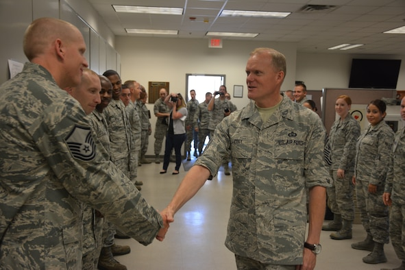 Chief Master Sgt. of the Air Force James A. Cody greets Master Sgt. Christopher Scott, 507th Security Forces Squadron during a visit to the reserve campus at Tinker Air Force Base during the August Unit Training Assembly. (U.S. Air Force Photo/Maj. Jon Quinlan)