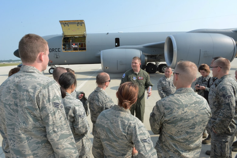 Airmen from across the state of Wisconsin receive a briefing from the boom operator prior to their KC-135 Stratotanker flight at the 128th Refueling Wing, Wis., July 31, 2014. The Airmen were selected to participate in the three-day Junior Enlisted Opportunity Program headed up by the state's first sergeants. They spent three days touring the 115th Fighter Wing, Volk Field and the 128 ARW to gain a better understanding of each bases' mission. (Air National Guard photo by Senior Airman Andrea F. Liechti)