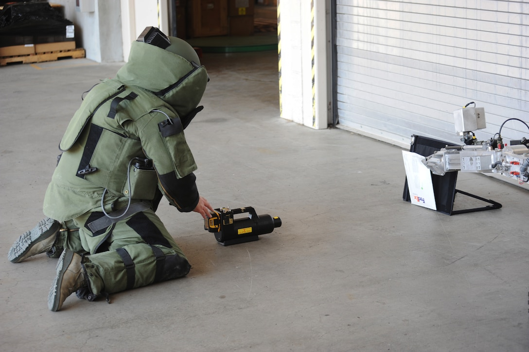 Tech. Sgt. Jason Ganner, an Explosive Ordinance Disposal Specialist, x-rays a suspicious package during a Wing Inspection Team exercise, Aug. 1, 2014, Portland Air National Guard Base, Ore.  (U.S. Air National Guard photo by Tech. Sgt. John Hughel, 142nd Fighter Wing Public Affairs/Released)