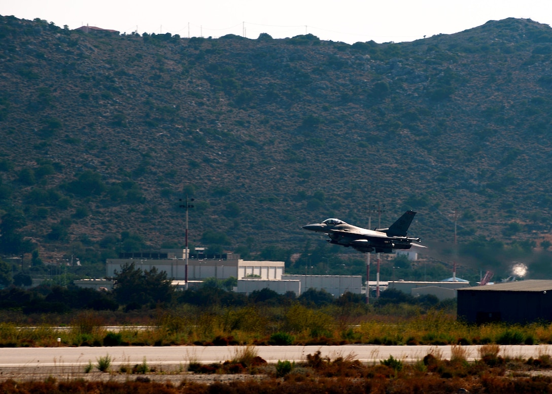 A U.S. Air Force F-16 Fighting Falcon fighter aircraft pilot takes off Aug. 12, 2014, from the flightline at Souda Bay, Greece, during a two-week training event with the Hellenic air force. The two nations partnered to enhance their breadth of air dominance. (U.S. Air Force photo by Staff Sgt. Daryl Knee/Released)