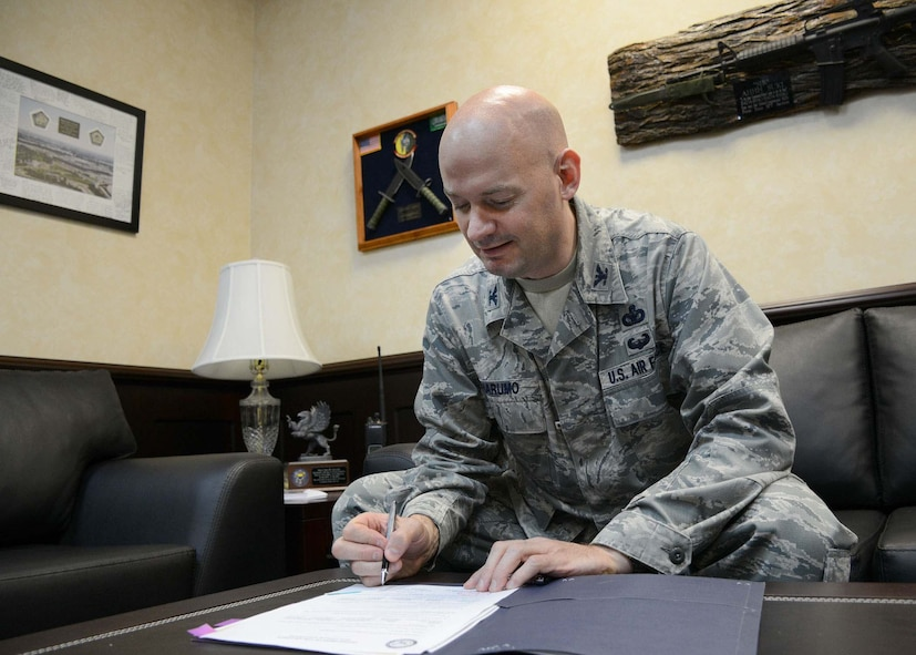 Col. Mark Anarumo, 39th Air Base Wing vice commander, sings off on various documents in his office Aug. 12, 2014, Incirlik Air Base, Turkey. Anarumo officially became the wings new vice commander on July 15, after serving at Headquarters U.S. Air Force, Washington D.C., as the programing branch chief. (U.S. Air Force photo by Staff Sgt. Veronica Pierce)