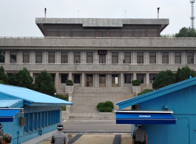 Members of the Republic of Korea and Democratic People's Republic of Korea militaries maintain sight of one another in the Joint Security Area near the Demilitarized Zone on the Korean peninsula, Aug. 13, 2014. Visitors may also view the inside of the Military Armistice Committee building where meetings between the two Koreas are held. (U.S. Air Force photo/Airman 1st Class Ashley J. Thum)