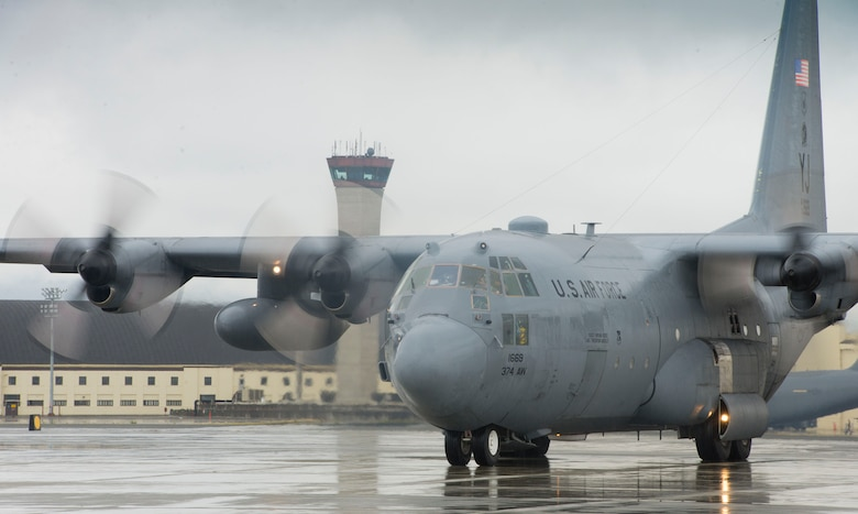 A C-130 Hercules waits for approval from the air traffic control tower prior to takeoff Aug. 5, 2014, during an off-site training sortie at Joint Base Elmendorf-Richardson, Alaska. The training prepared aircrew personnel for the upcoming Red Flag-Alaska exercise. The C-130 is assigned to the 36th Airlift Squadron. (U.S. Air Force photo/Staff Sgt. Chad C. Strohmeyer)