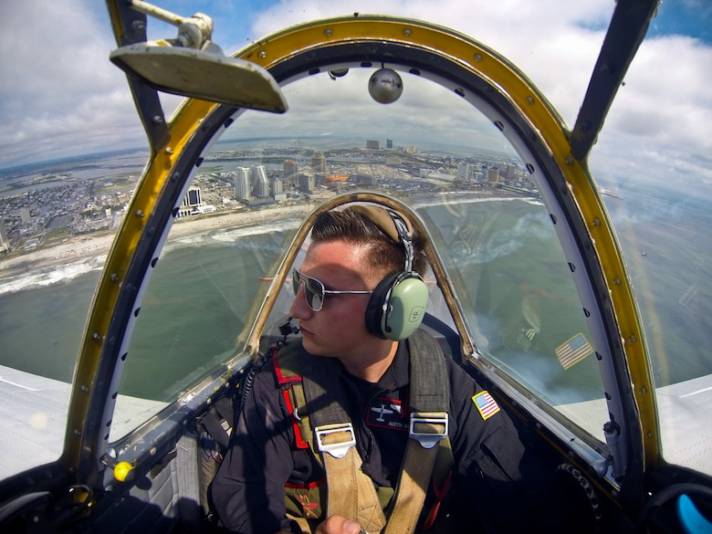 Senior Airman Austin Daniel flies with the Raiders Flight Demonstration Team in a Yakovlev Yak-52 demonstration aircraft Aug. 13, 2014, over the beaches of Atlantic City, N.J. during the Thunder Over the Boardwalk Air Show.  Daniel, an Airman with the New Jersey Air National Guard's 177th Fighter Wing, is an F-16C Fighting Falcon crew chief. (U.S. Air National Guard photo/Tech. Sgt. Matt Hecht)