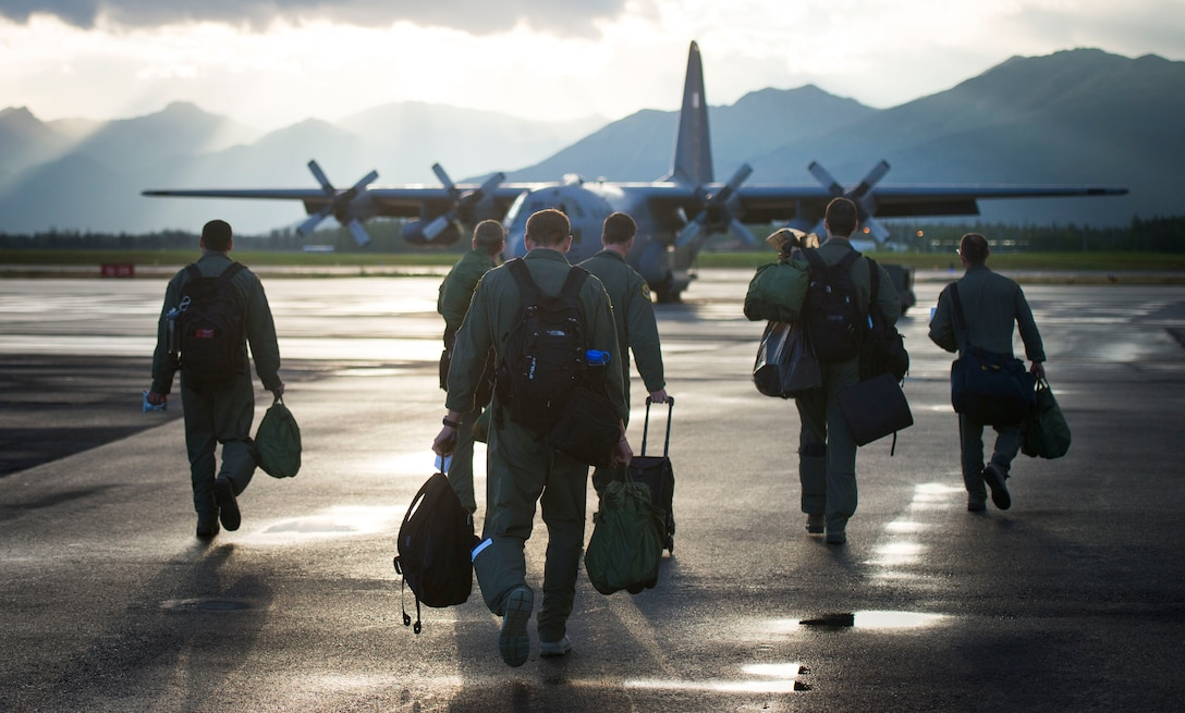 Members from the 36th Airlift Squadron step to their aircraft during the first day of Red Flag-Alaska Aug. 11, 2014, at Joint Base Elmendorf-Richardson, Alaska. Red Flag-Alaska is an exercise that provides joint offensive counter-air, interdiction, close air support, and large force employment training in a simulated combat environment. (U.S. Air Force photo/Staff Sgt. Chad C. Strohmeyer)