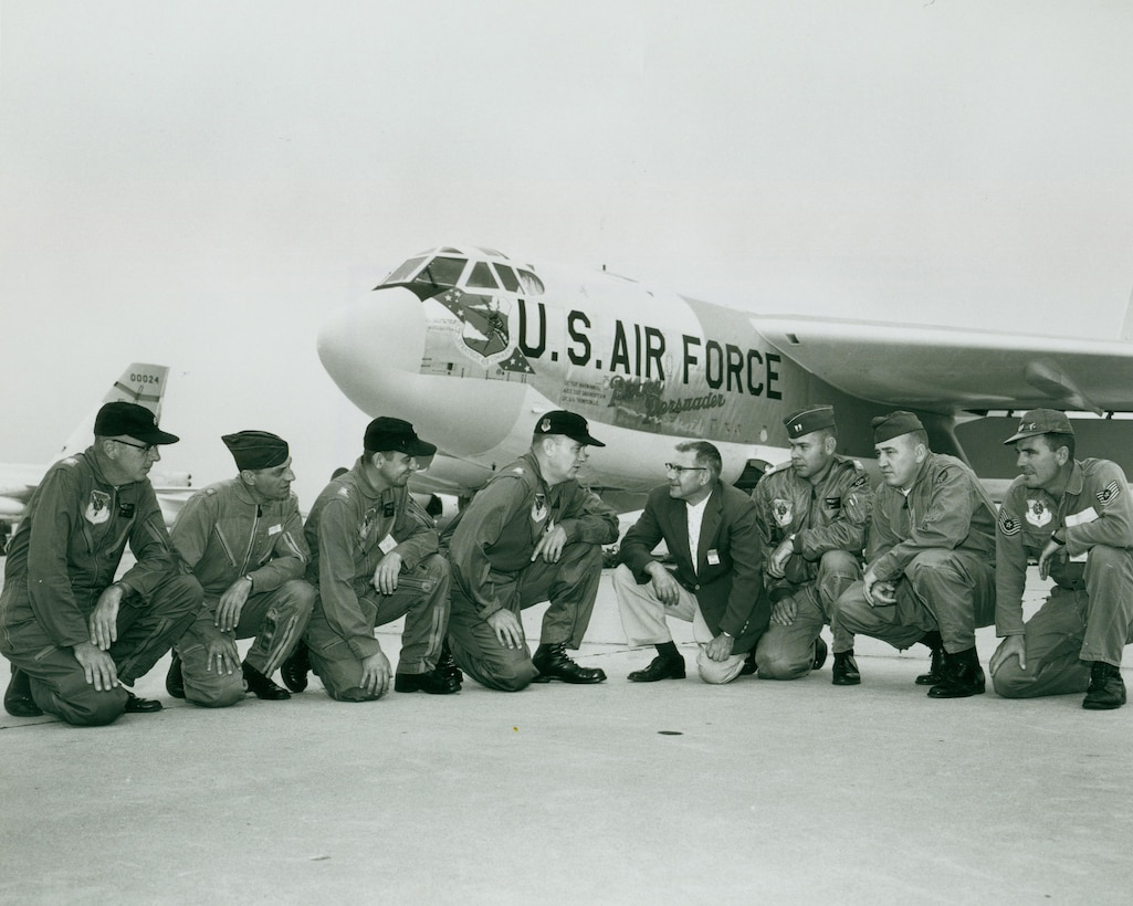 """Base leadership and former North Dakota governor, William Guy, kneel in front of the """"Peace Persuader"""" on Minot Air Force Base in July of 1961. This was the first B-52H Stratofortress delivered to the base. -- (Courtesy Photo)"""