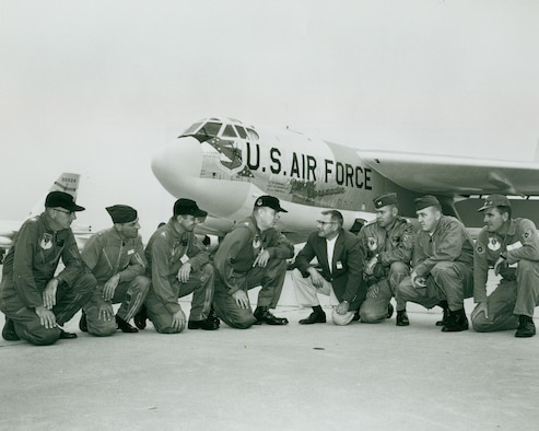 "Base leadership and former North Dakota governor, William Guy, kneel in front of the ""Peace Persuader"" on Minot Air Force Base in July of 1961. This was the first B-52H Stratofortress delivered to the base. -- (Courtesy Photo)"
