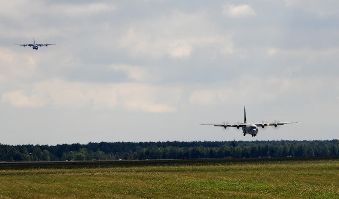 Two C-130J Super Hercules come in for a landing Aug. 14, 2014, at Powidz Air Base, Poland. The aircraft, deployed from Ramstein Air Base, Germany, are part of a training deployment in support of Operation Atlantic Resolve. (U.S. Air Force photo/Staff Sgt. Jarad A. Denton)